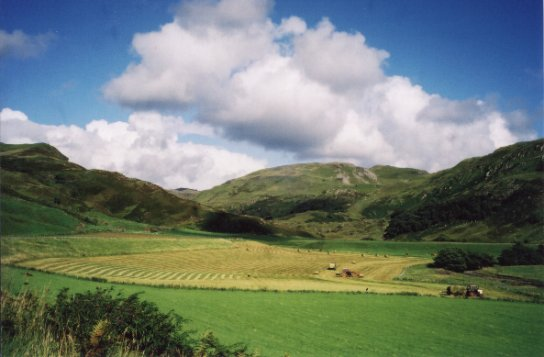 August 01, A view looking up the glen with the Arable Silage baling in the foreground